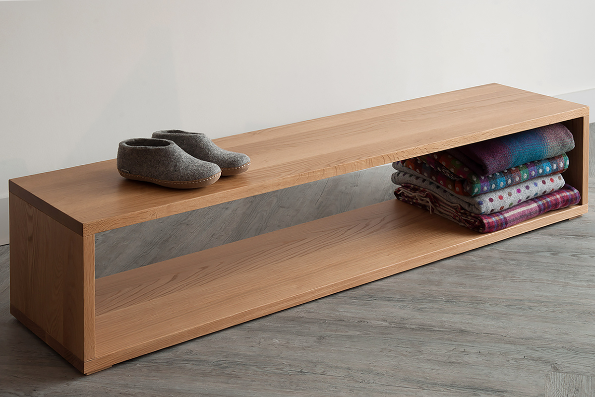 An Oak end of bed wooden storage bench by Black Lotus for natural bed company