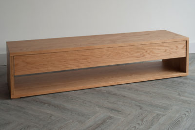 End of bed storage bench with drawer and open shelf in Oak.