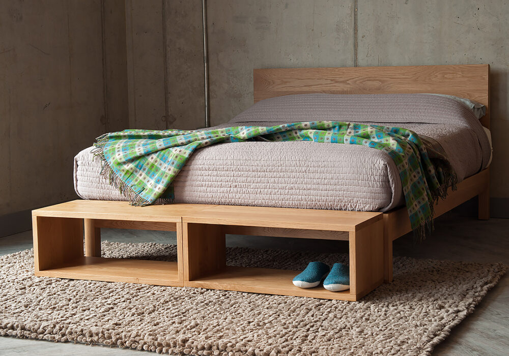 Black Lotus small open Cube tables as end of bed storage in Oak