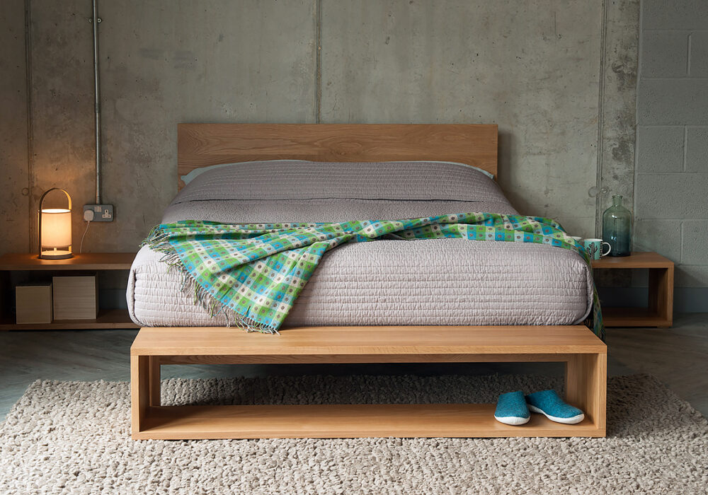 Cube open shelf tables as end-of-bed storage and bedsides all in Oak.
