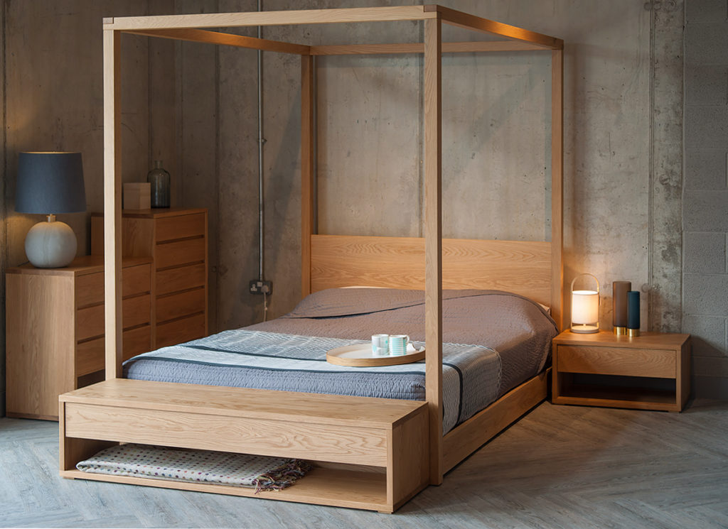Industrial bedroom look with warm Oak furniture. Cube 4 Poster bed is the centrepiece, with Cube collection chests and an end of bed bench.