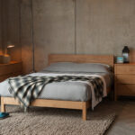 Industrial look bedroom with solid Oak Malabar bed, Oak storage drawers and grey bedding.