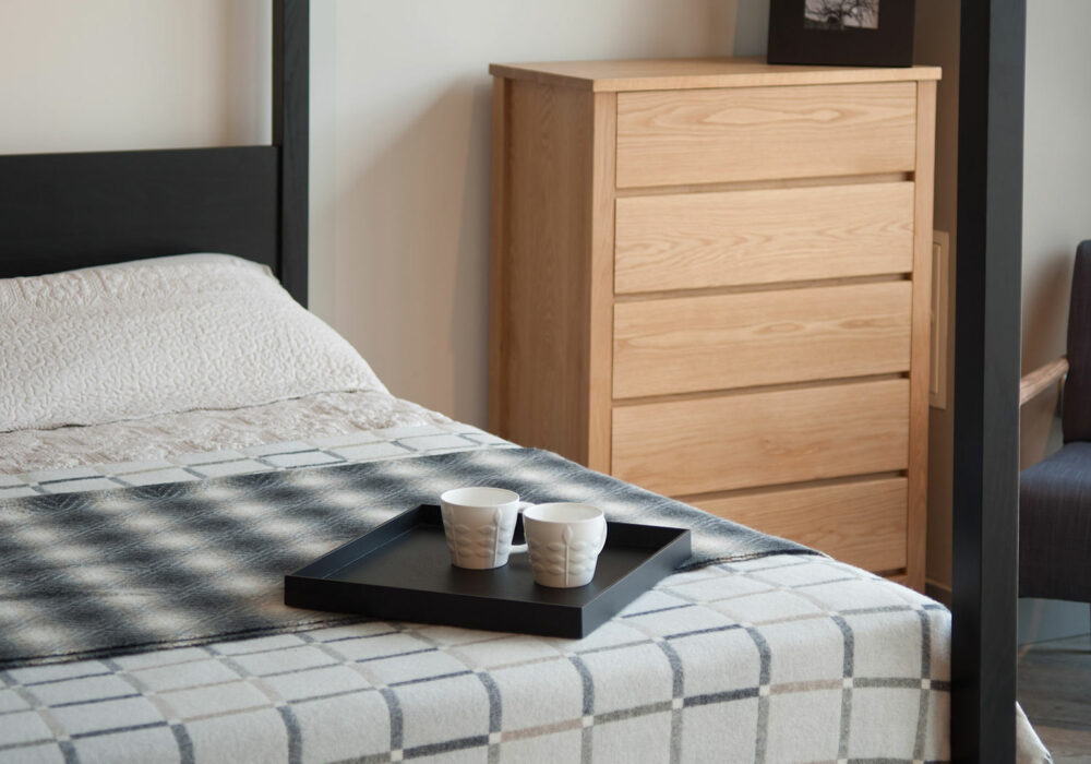 black painted oak Orchid 4 Poster bed shown with an Oak tallboy