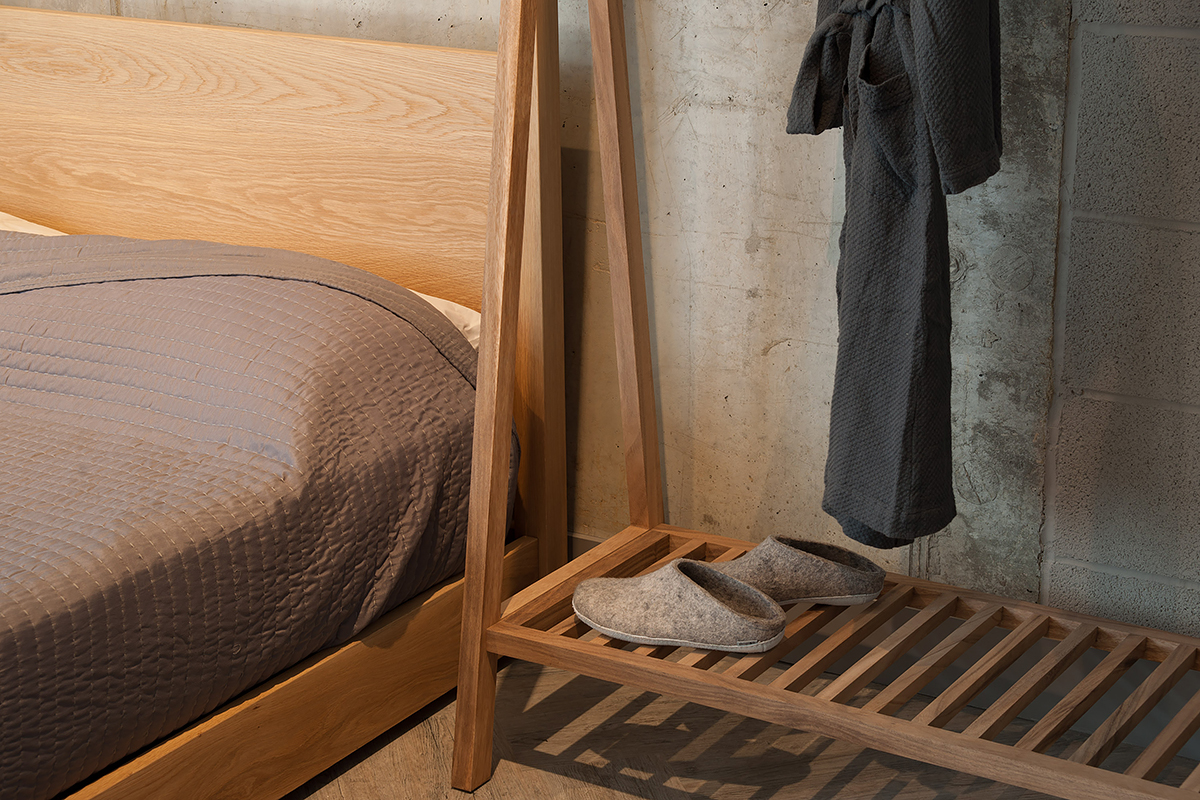 A view of the slatted shelf of the wooden clothes hanging rail