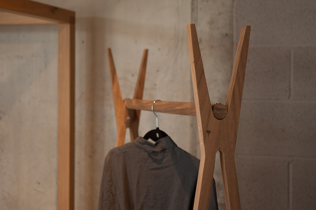 A closer view of the wooden clothes hanging rail