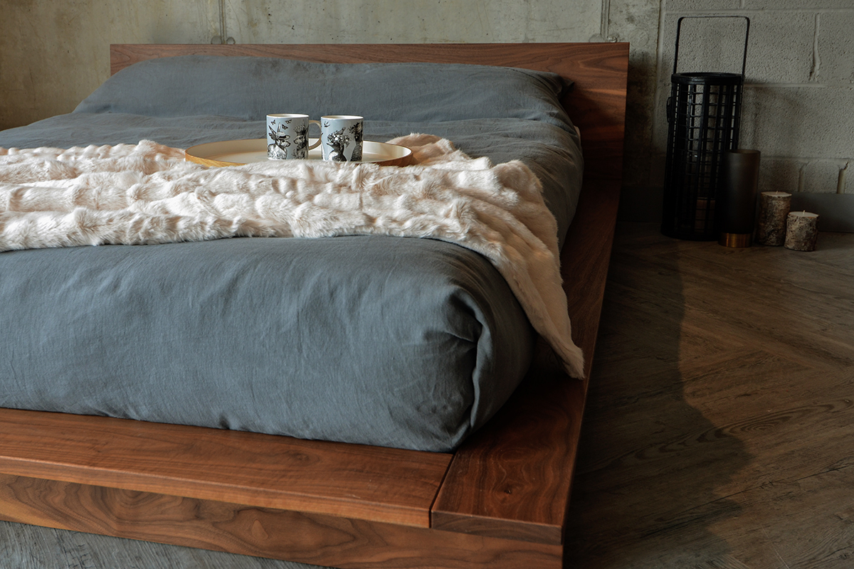 cream faux fur throw on Oregon platform style wooden bed