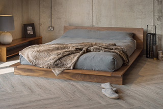 Contemporary solid wood platform bed the Oregon, here shown in solid walnut