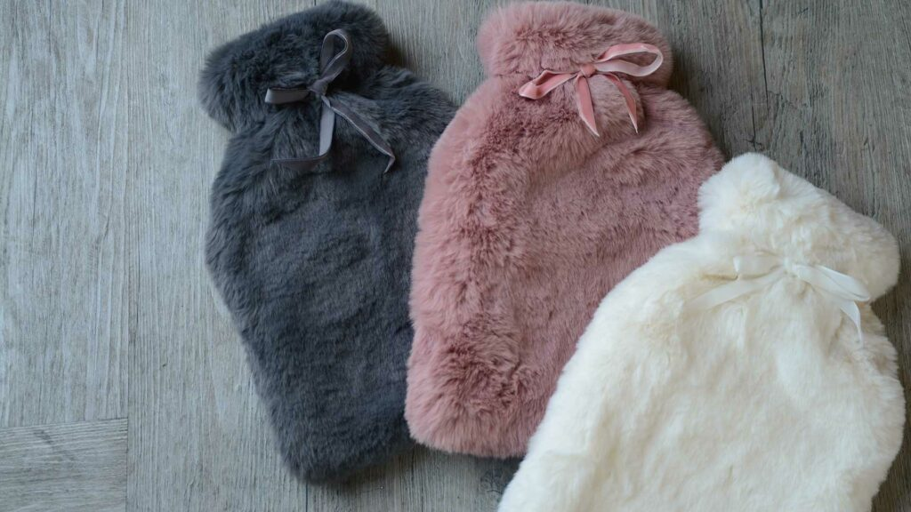 luxuriously soft faux fur covered hot water bottles in 3 colours