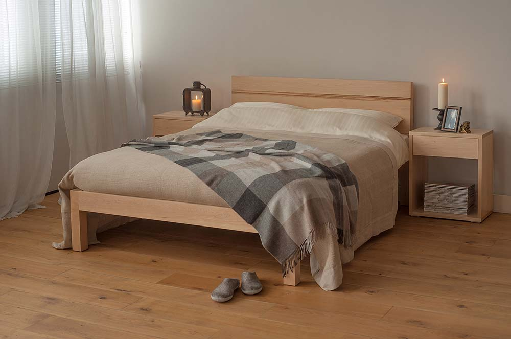 Chunky modern Tibet bed made from solid wood, here in Maple with Maple bedside Cube tables