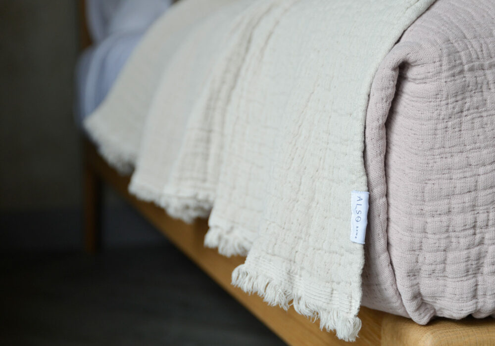 pure cotton crinkled effect throws up close and in white and blush pink