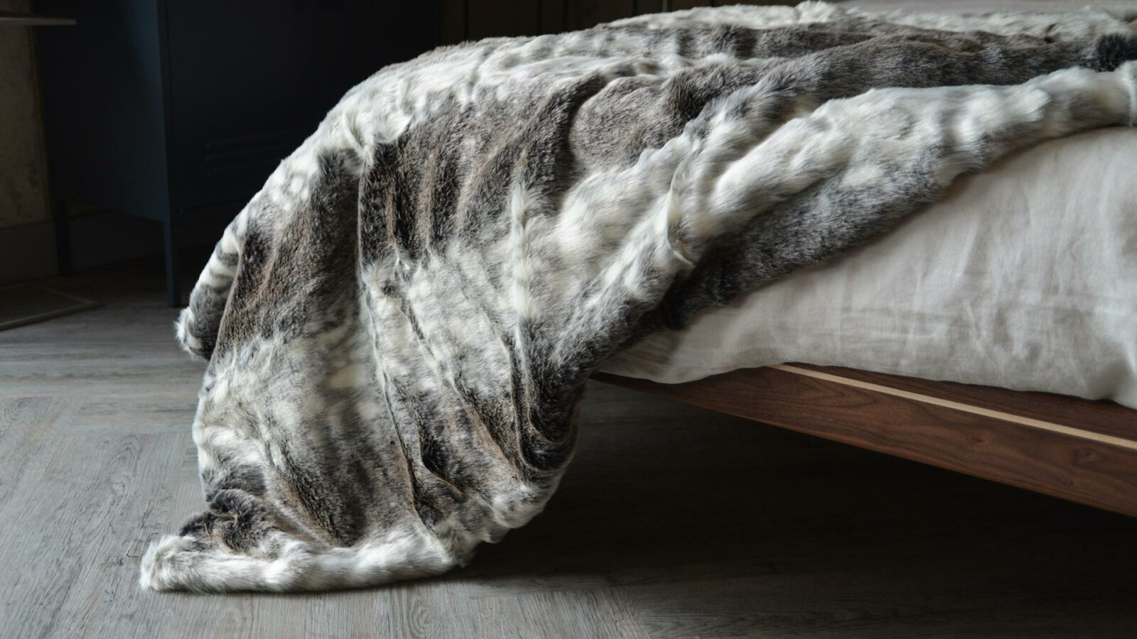 Softest faux fur throw in grey colours and white