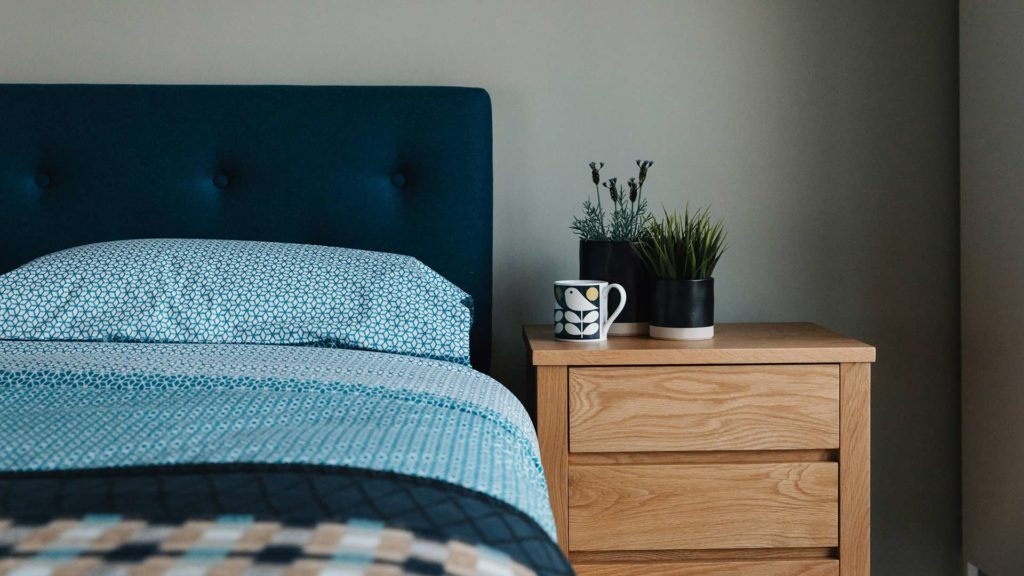 Arran-headboard-with-Sashiko-bedding-and-Shaker-oak-bedside