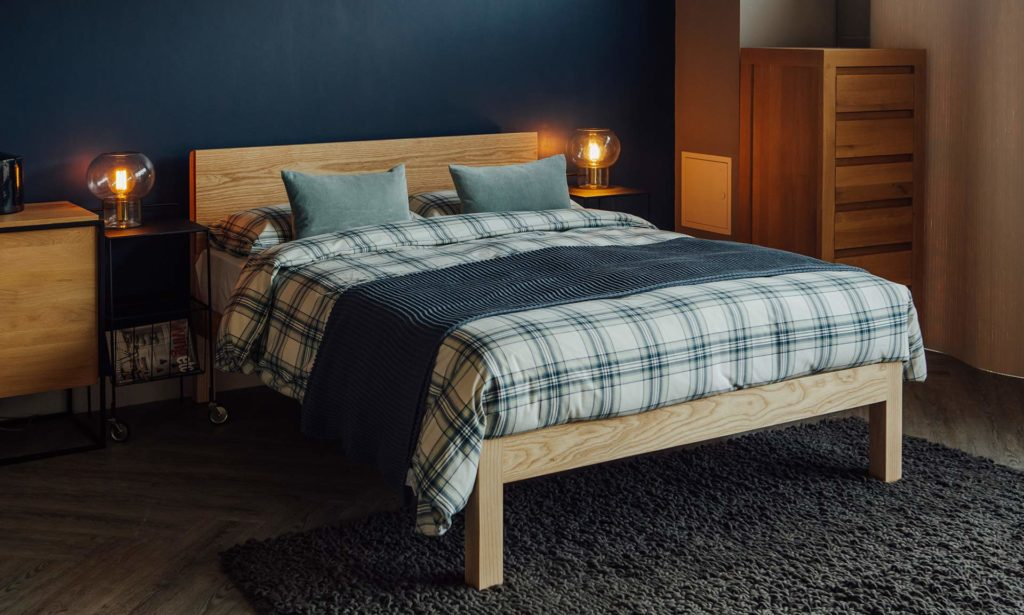 Tibet a modern solid wood bed made in Britain shown in Ash