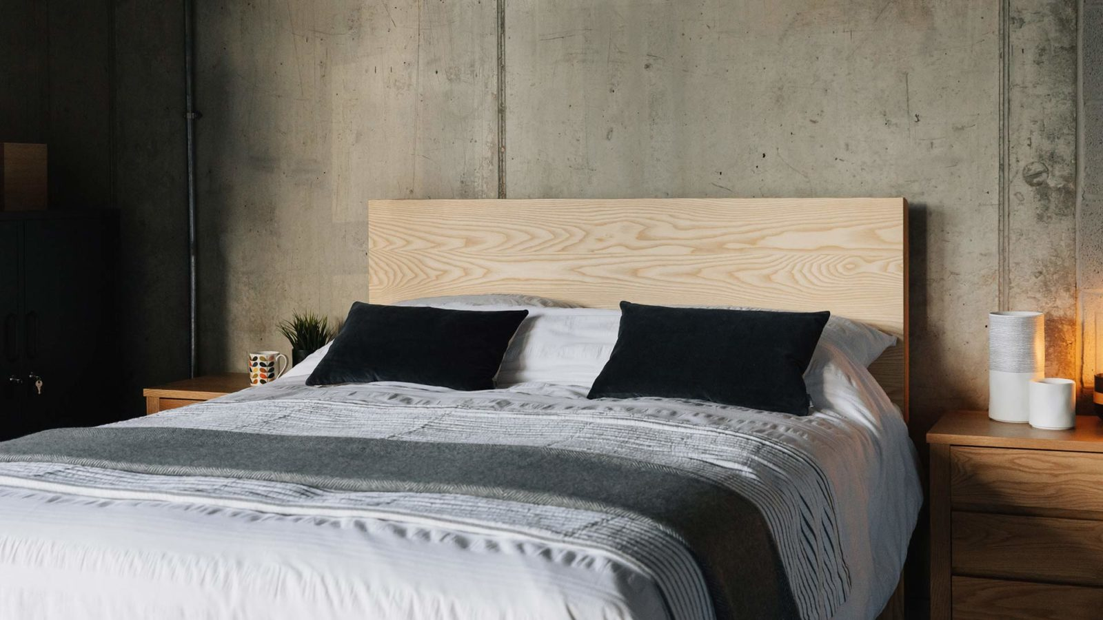 Bamford a chunky solid wood bed with a taller headboard here made from Ash