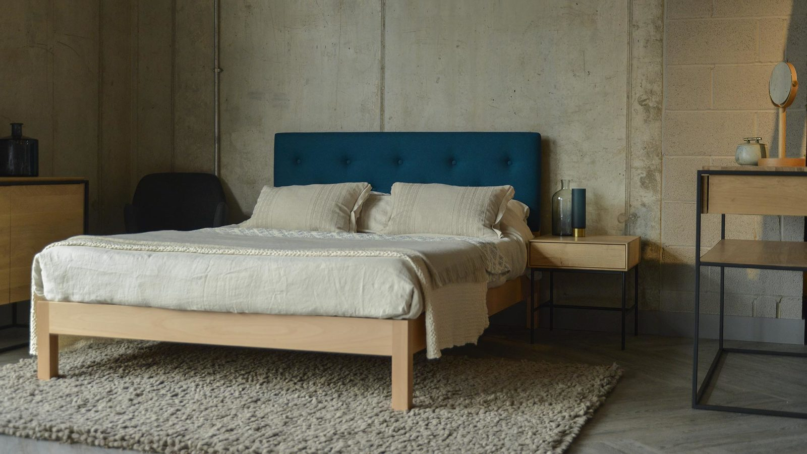 Beech Arran contemporary upholstered bed with Marine blue Amatheon fabric headboard