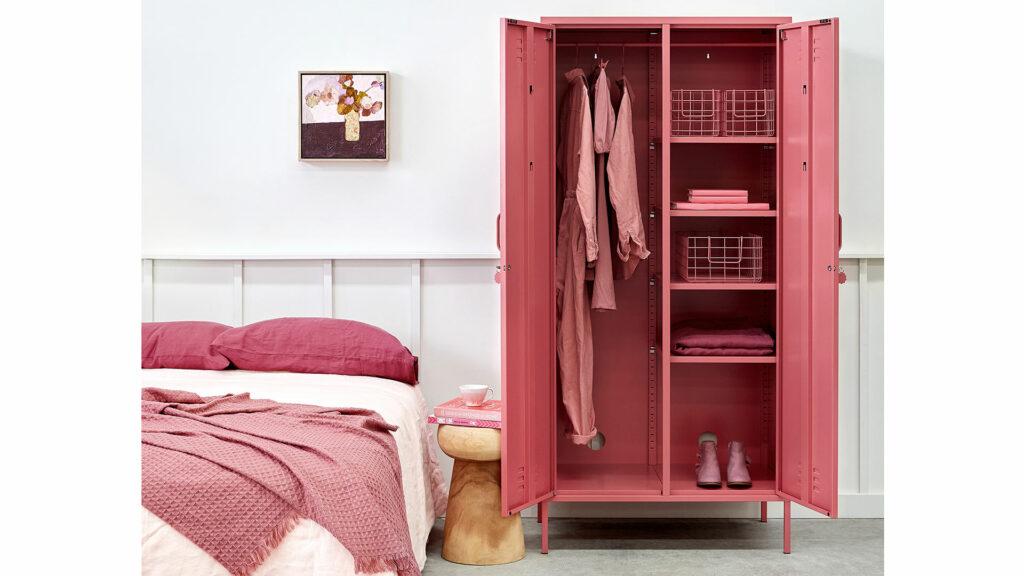 wardrobe storage locker in berry pink shown with both doors open