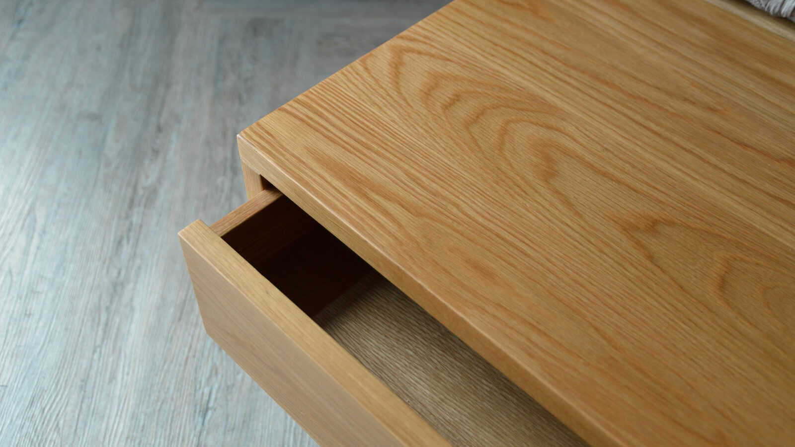 looking down on our Oak wide storage bench with open drawer
