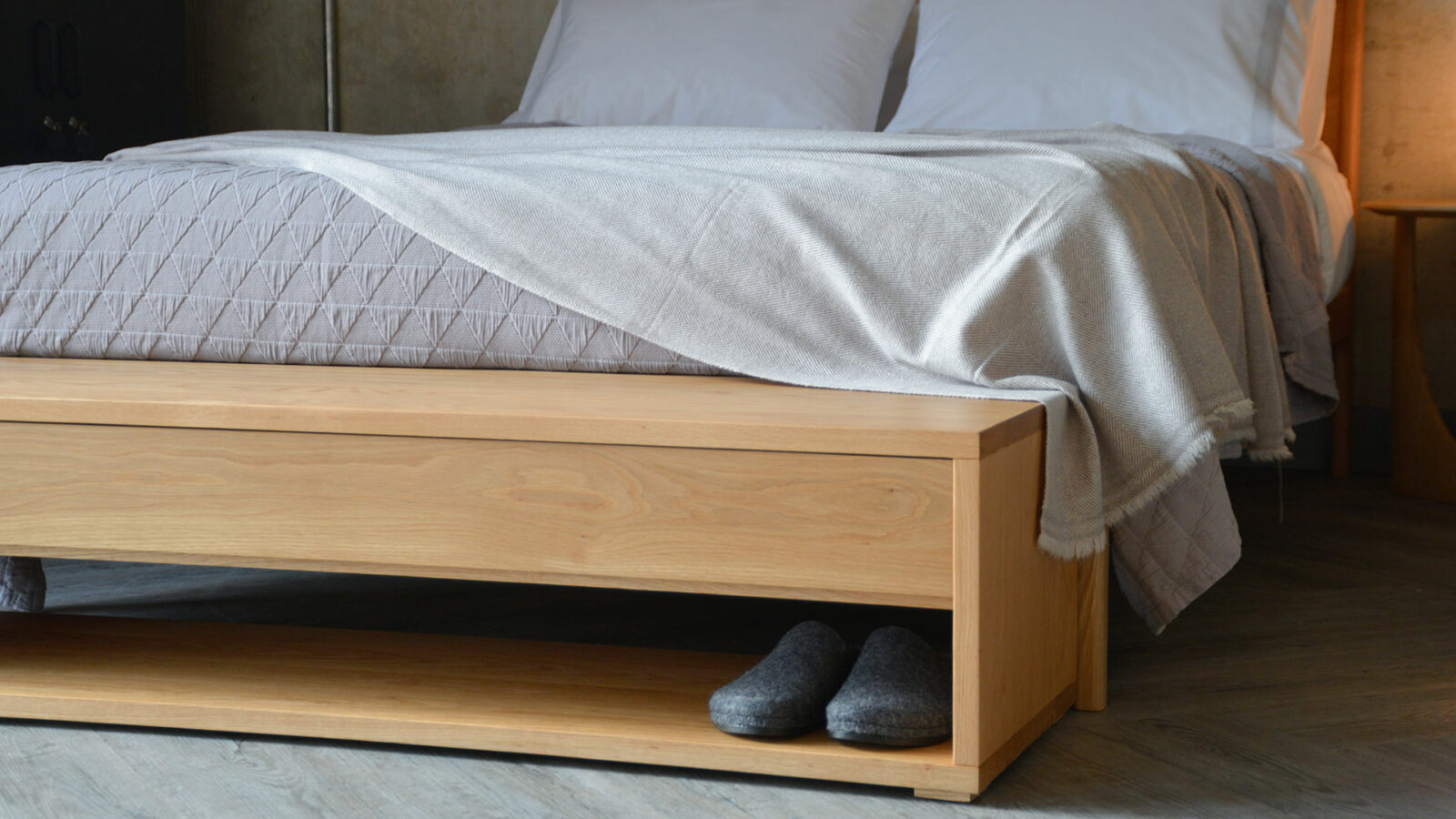 a closer view of our media unit or end of bed bench with storage drawer and open shelf, here in Oak