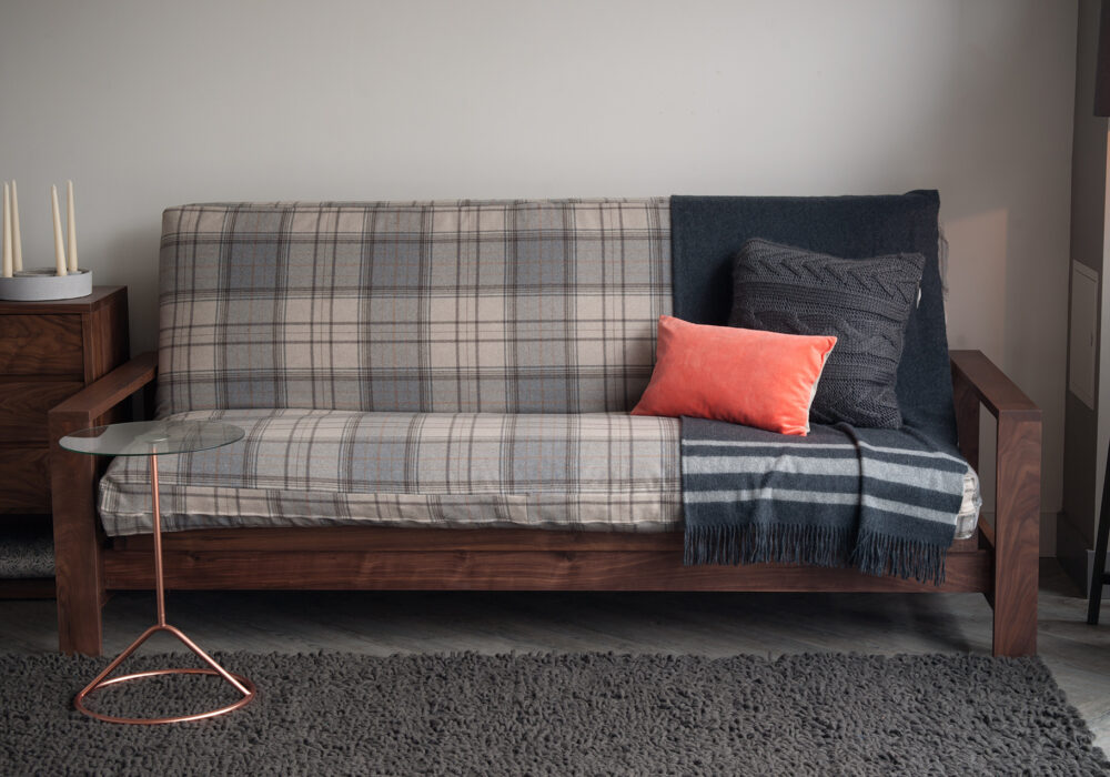 Black Lotus cuba futon sofa-bed with a wool loose cover and in Walnut