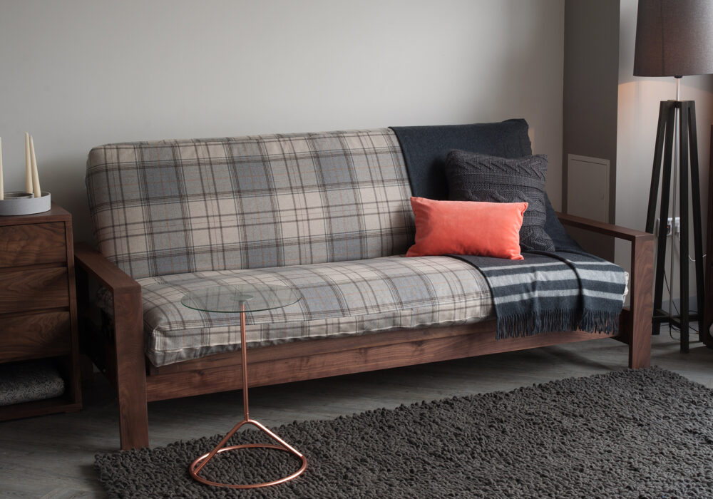Black Lotus Cuba a sofa-bed with a futon mattress and in solid walnut