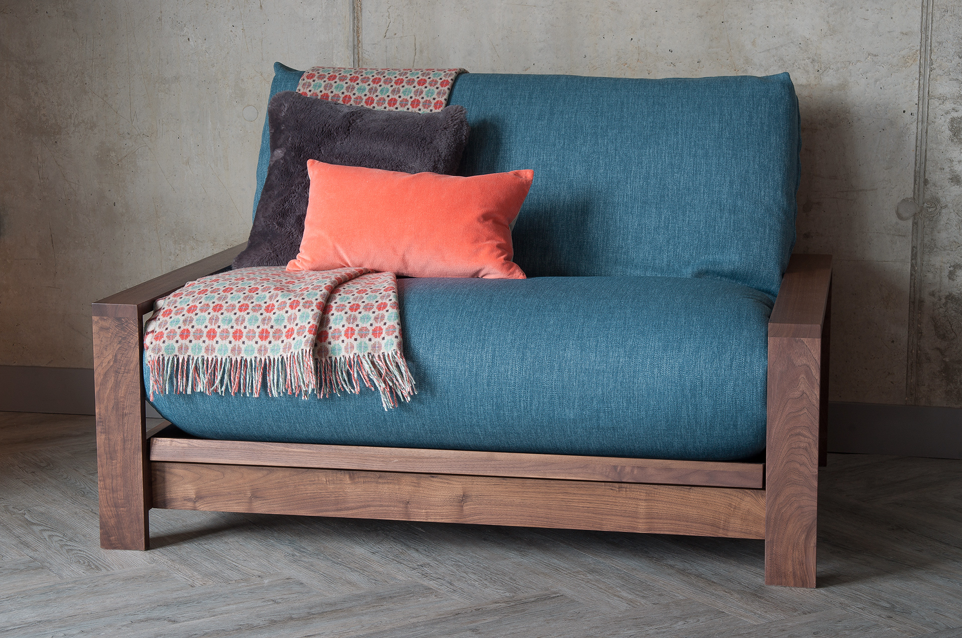 Black Lotus Walnut Panama sofa bed showing futon mattress in a loose cover