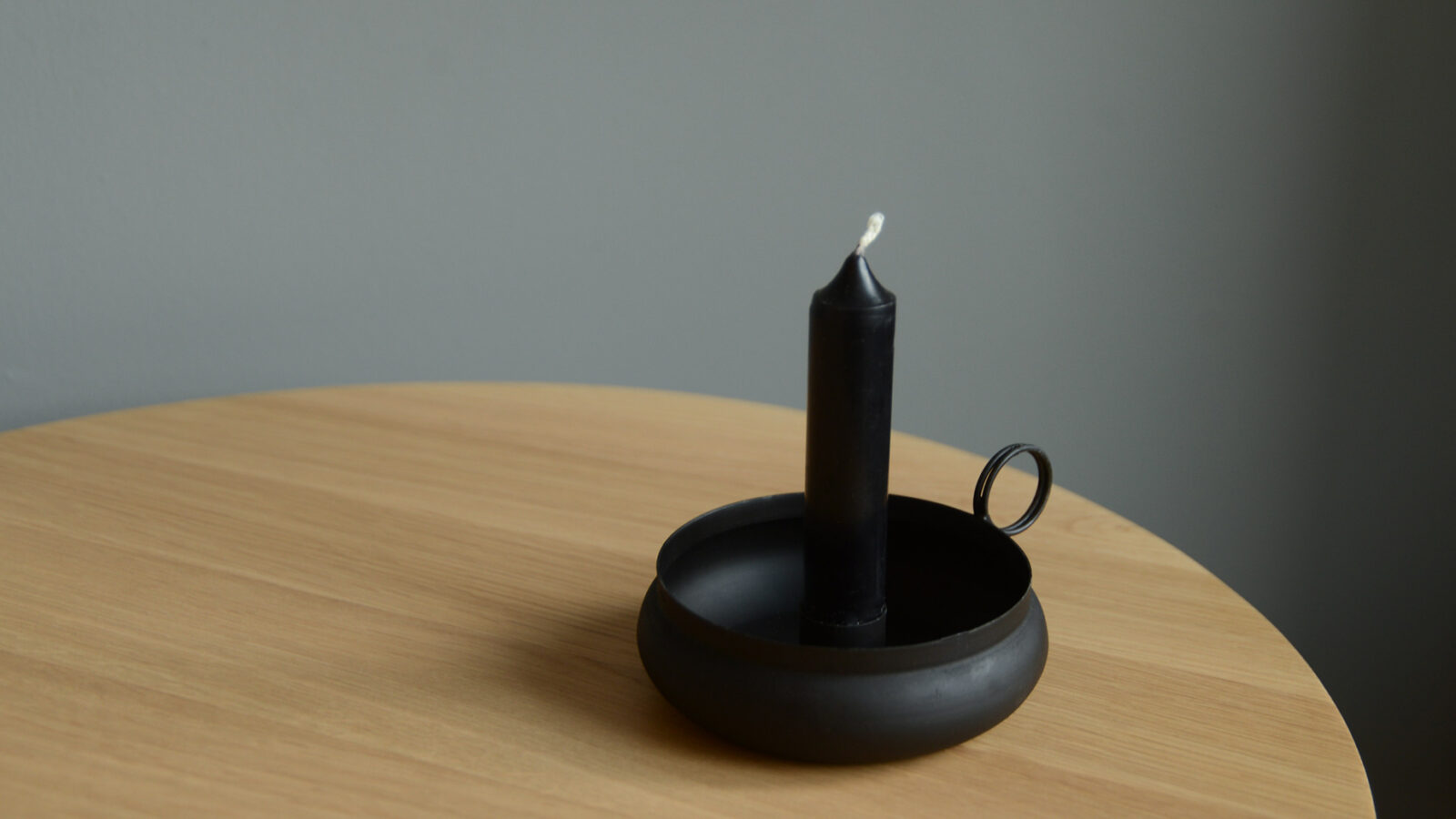 Black metal old fashioned candle holder
