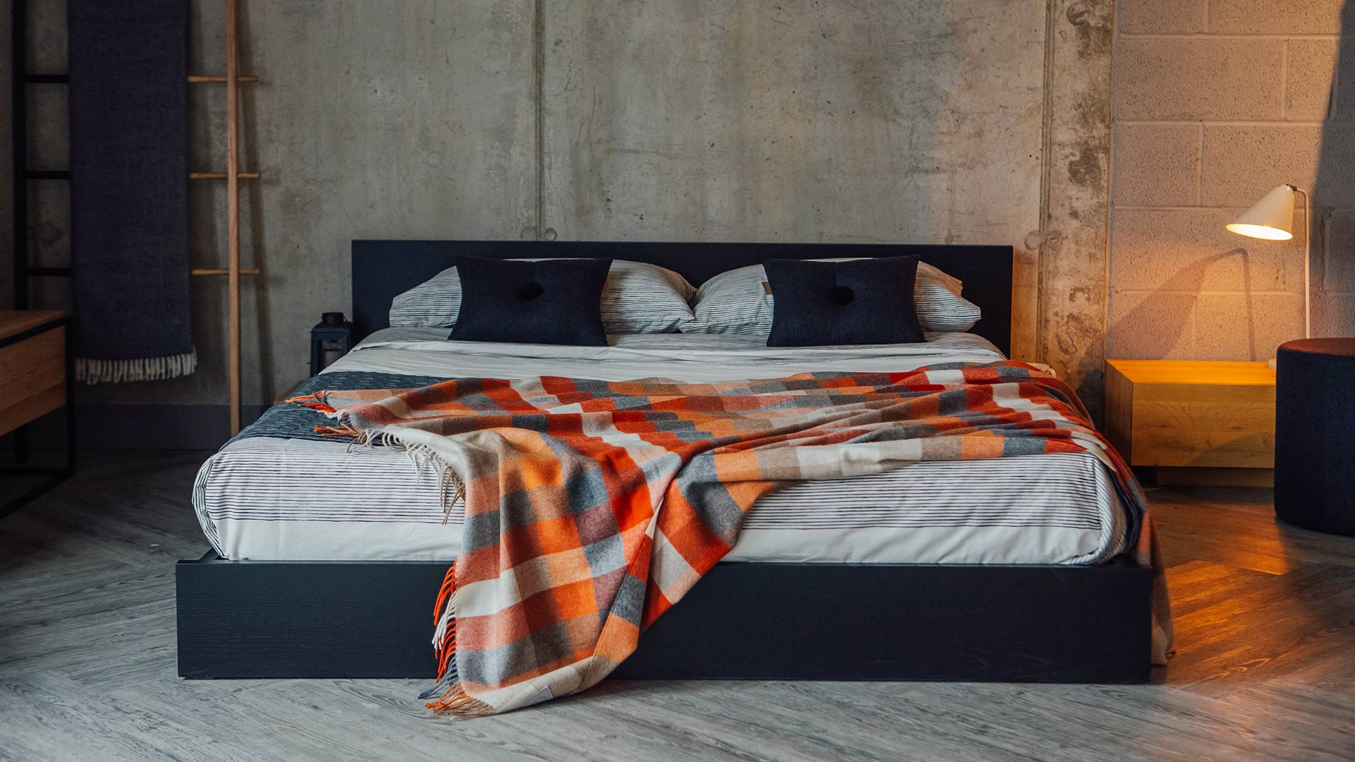 Kulu is a low solid wood bed with optional attached side tables