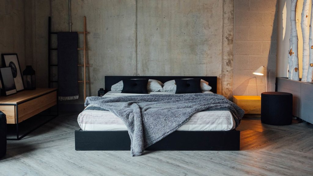 Kulu a low wooden platform style bed in Oak lacquered black