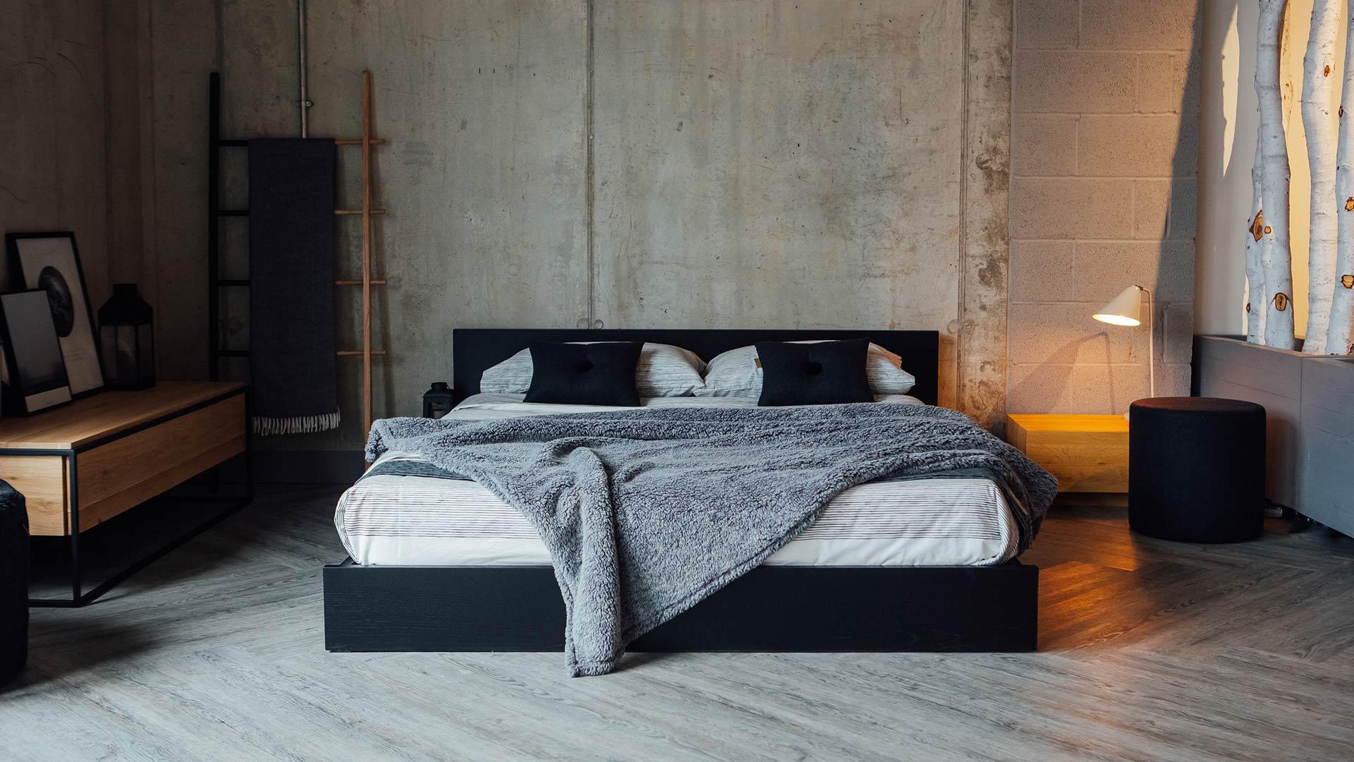 Kulu a low wooden platform style bed in Oak lacquered black