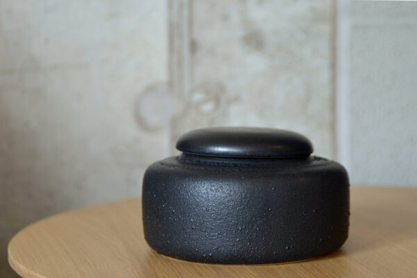 low black ceramic jar with lid