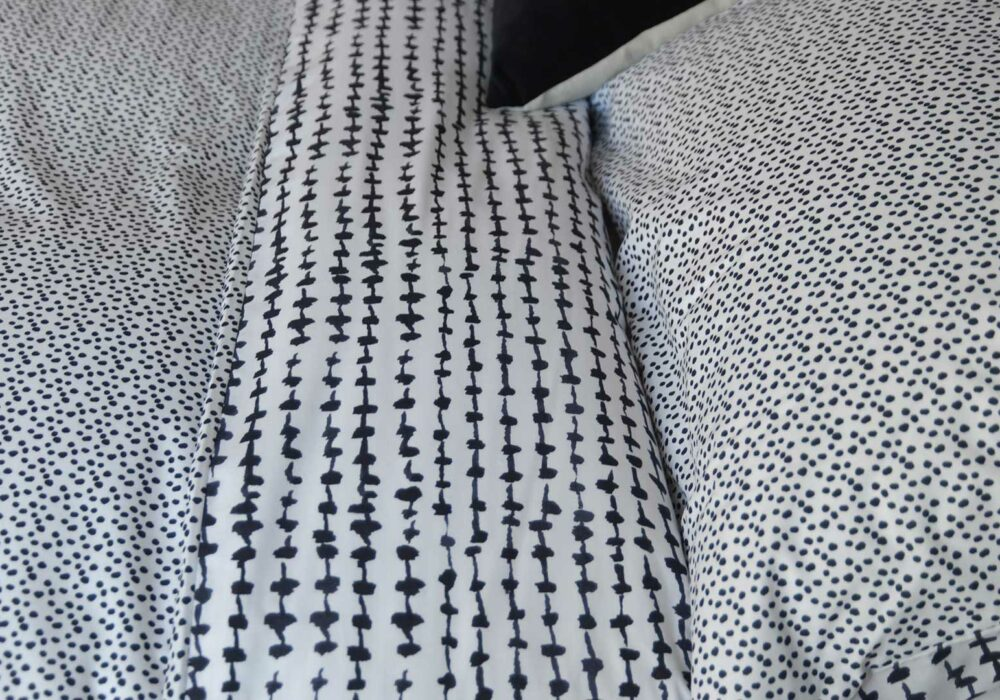 contemporary pattern reversible black and white duvet cover set, close up view