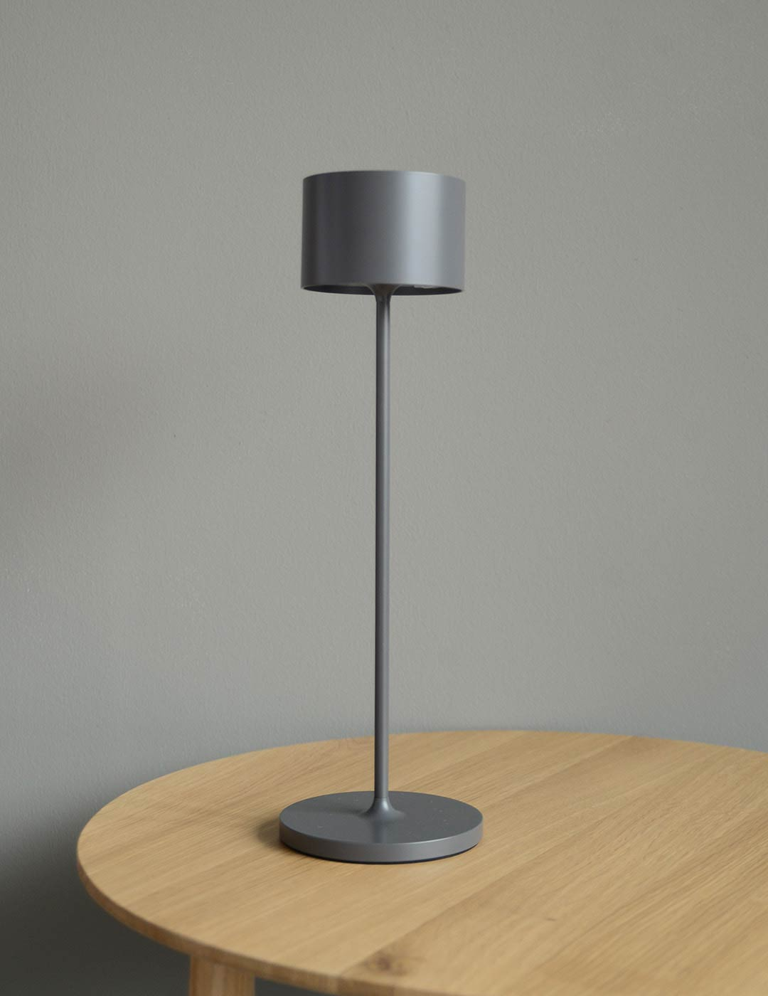 grey portable wireless table lamp for indoor and outdoor use