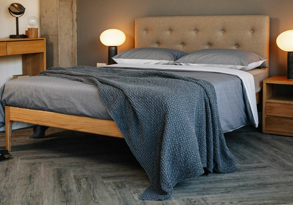 Bloomsbury a hand made solid wood bed with upholstered headboard