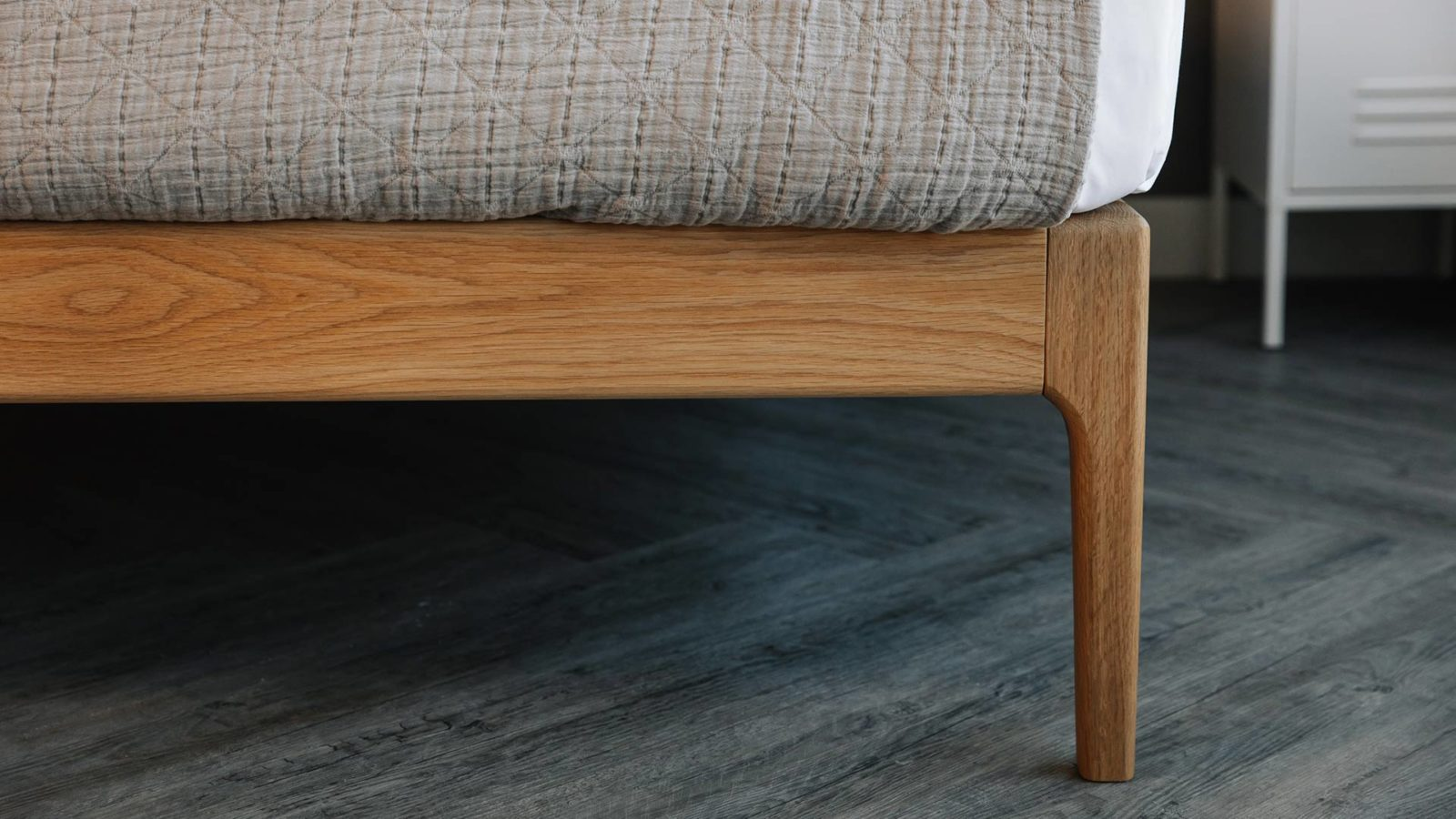 close-up pic of the curving solid wood Bloomsbury bed leg