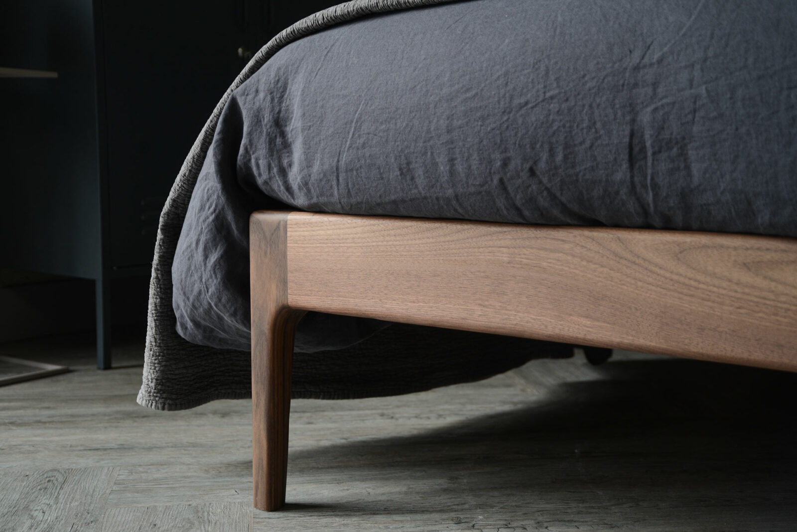 A closer view of the solid wood Bloomsbury bed leg, here in solid walnut