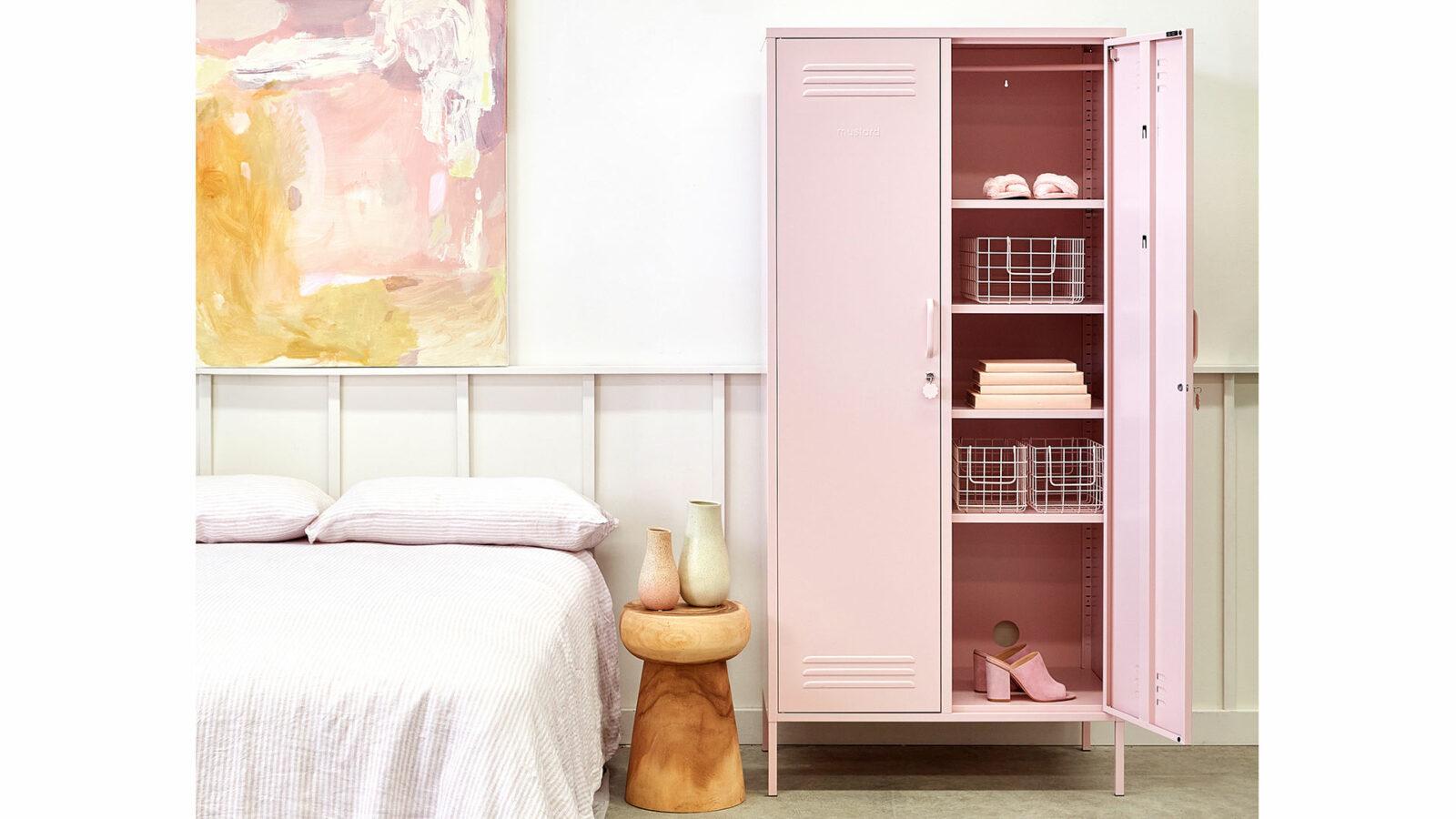 wardrobe storage locker in blush pink shown with one door open