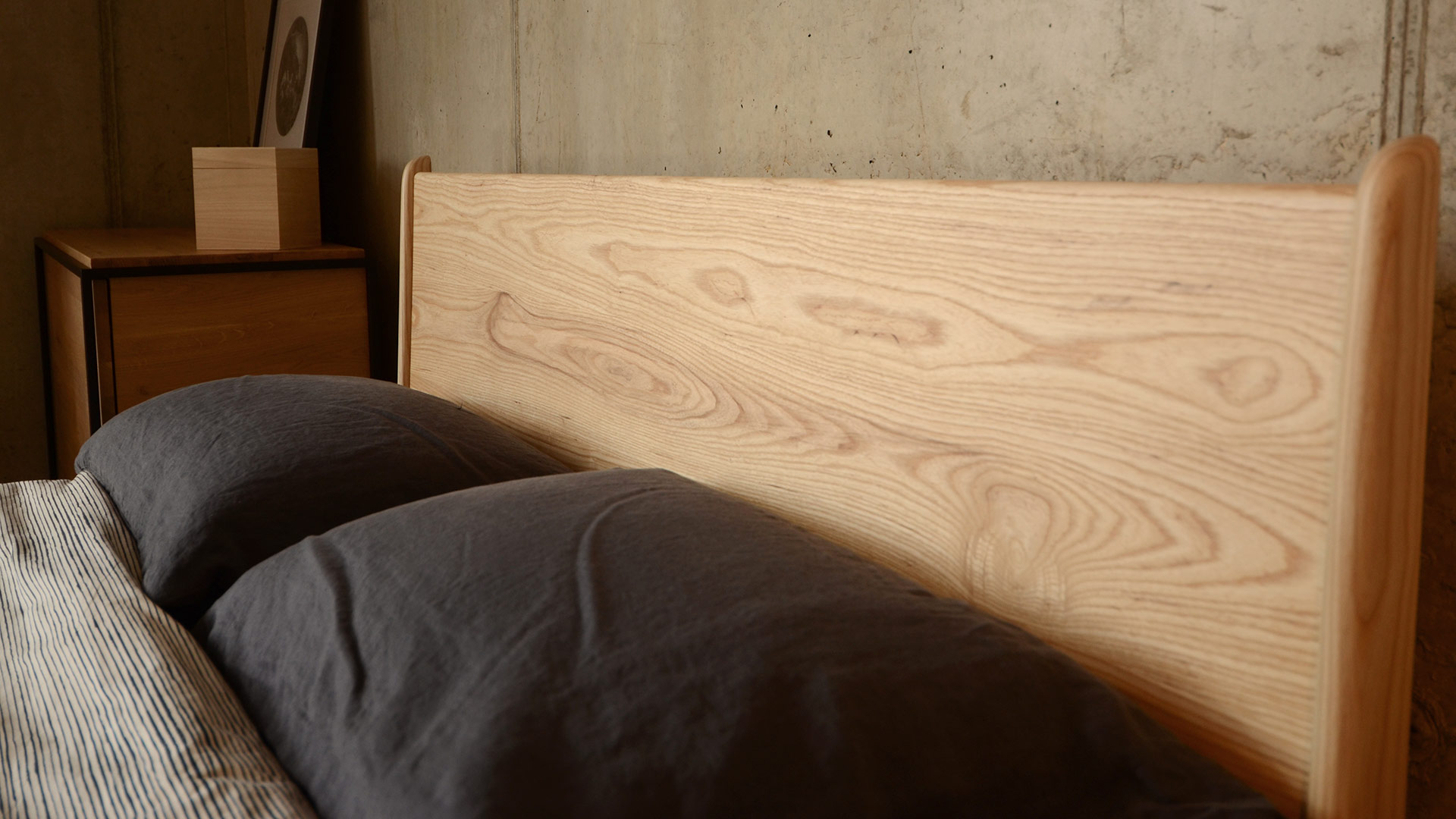 Headboard shot of the Mid-century style wooden Camden bed here in Ash