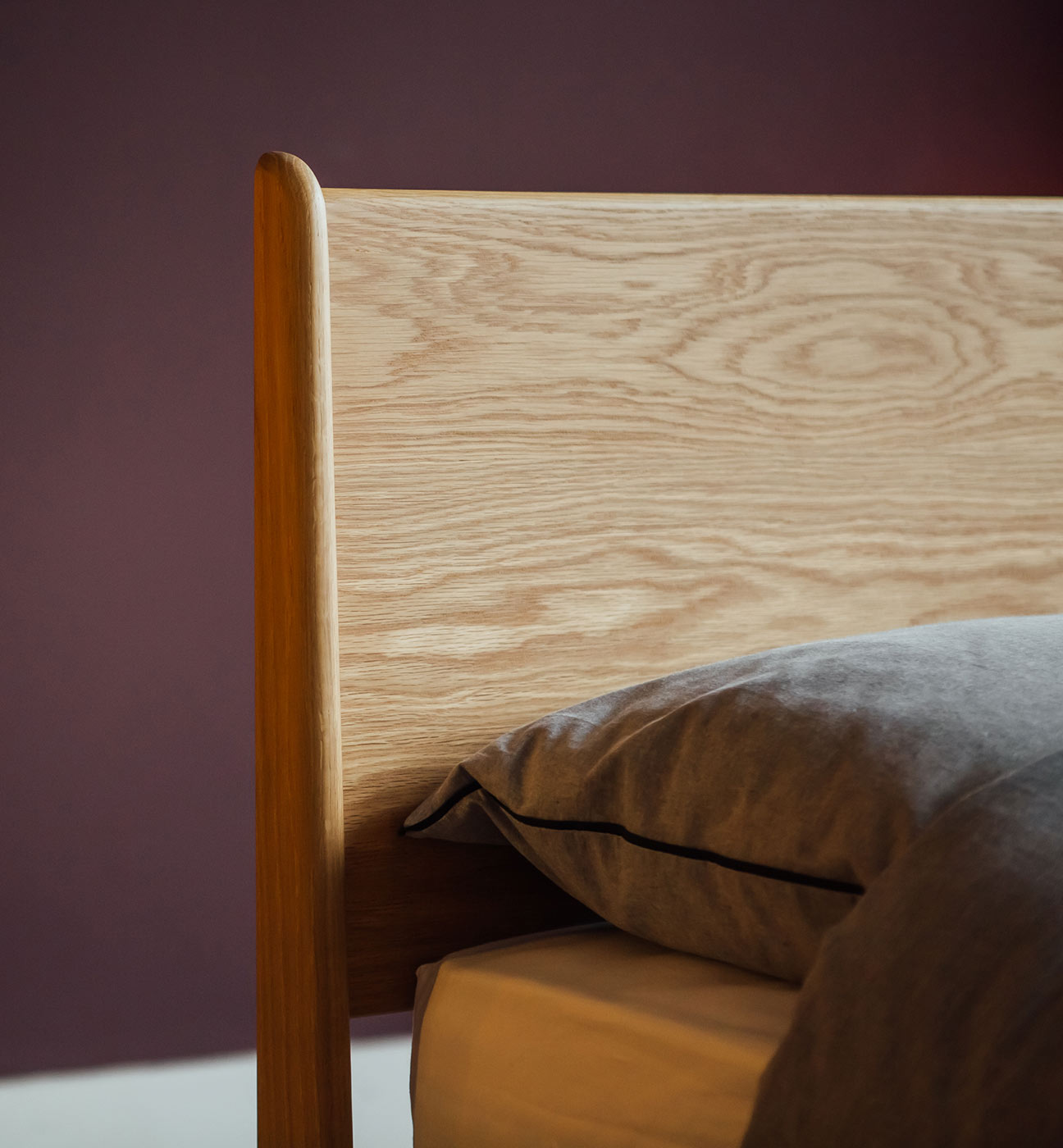 The Camden bed headboard has an elegant slender curve hand made from solid wood