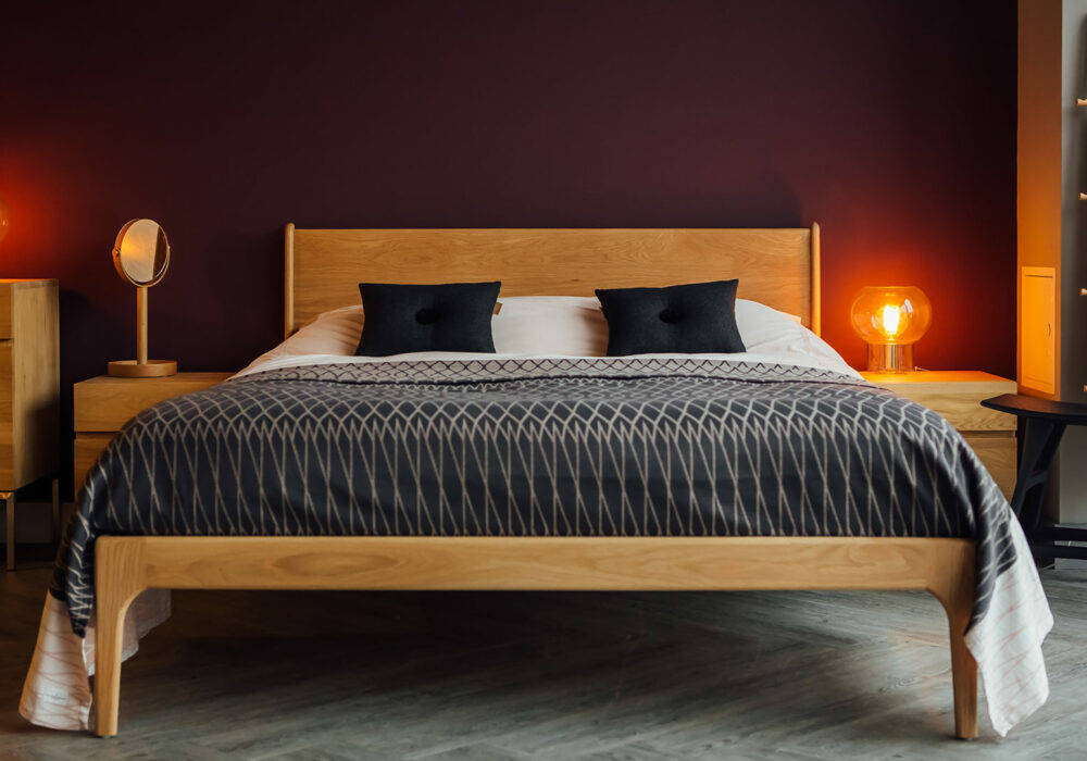 Mid Century style Camden bed in solid oak with organic cotton woven bedspread