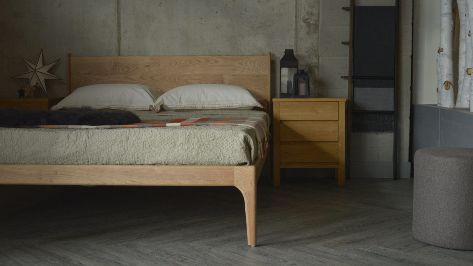 View from the foot end of the Camden wooden bed in Cherry
