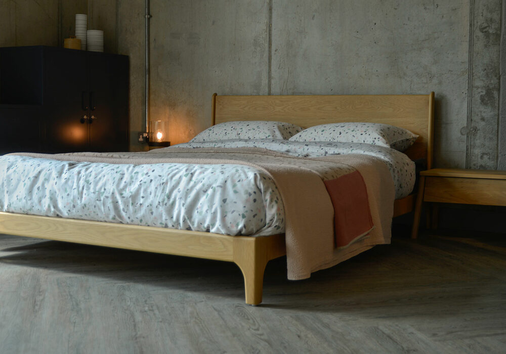 Hand made low wooden Carnaby Bed with the Air oak bedside drawer table
