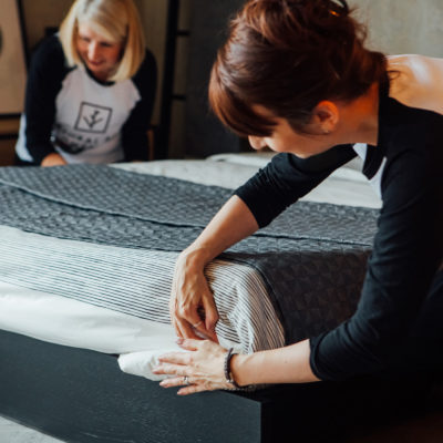 Caro-&-Paula-dressing-a-bed