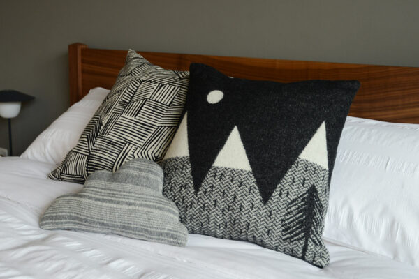 a group of donna wilson cushions