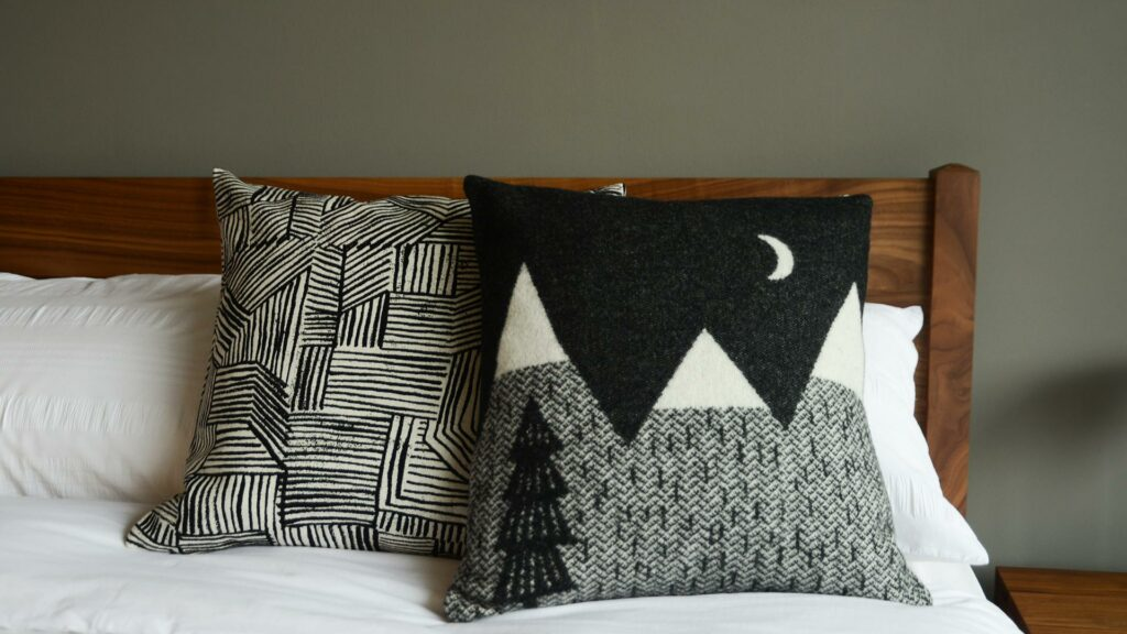 Donna Wilson knitted mountain scene cushion in black and white