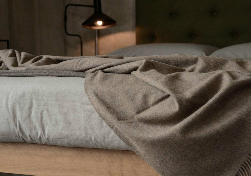 soft recycled wool throw in a brown marl color