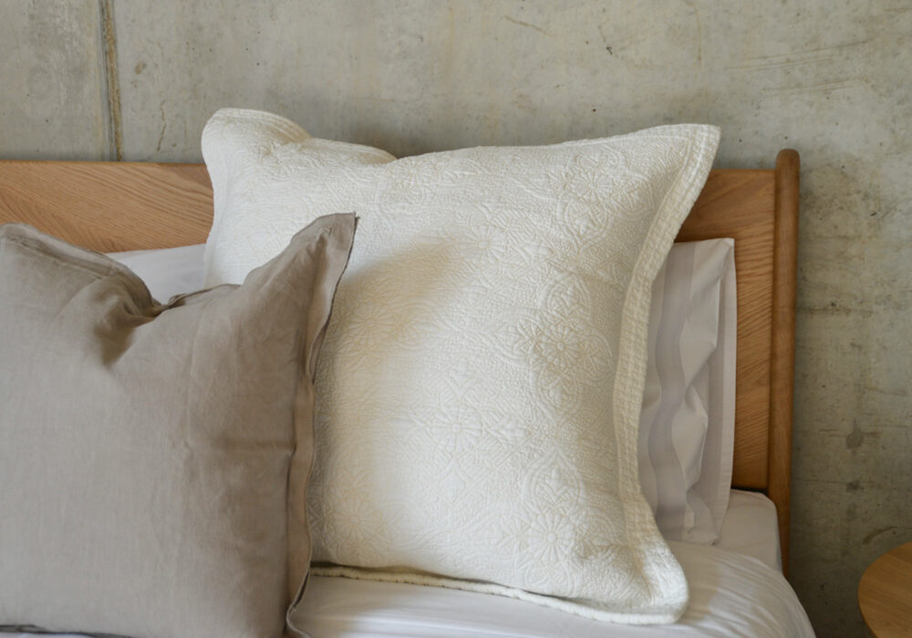 Ivory white stitched and quilted cushion cover for a large square pillow