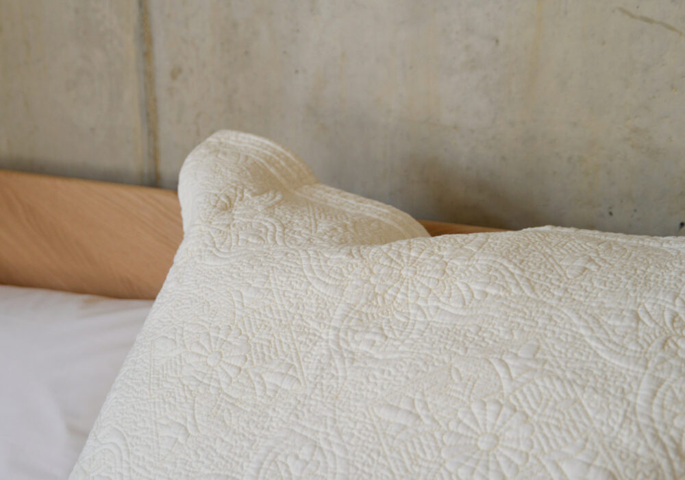 quilted and embroidered large square white pillowcase