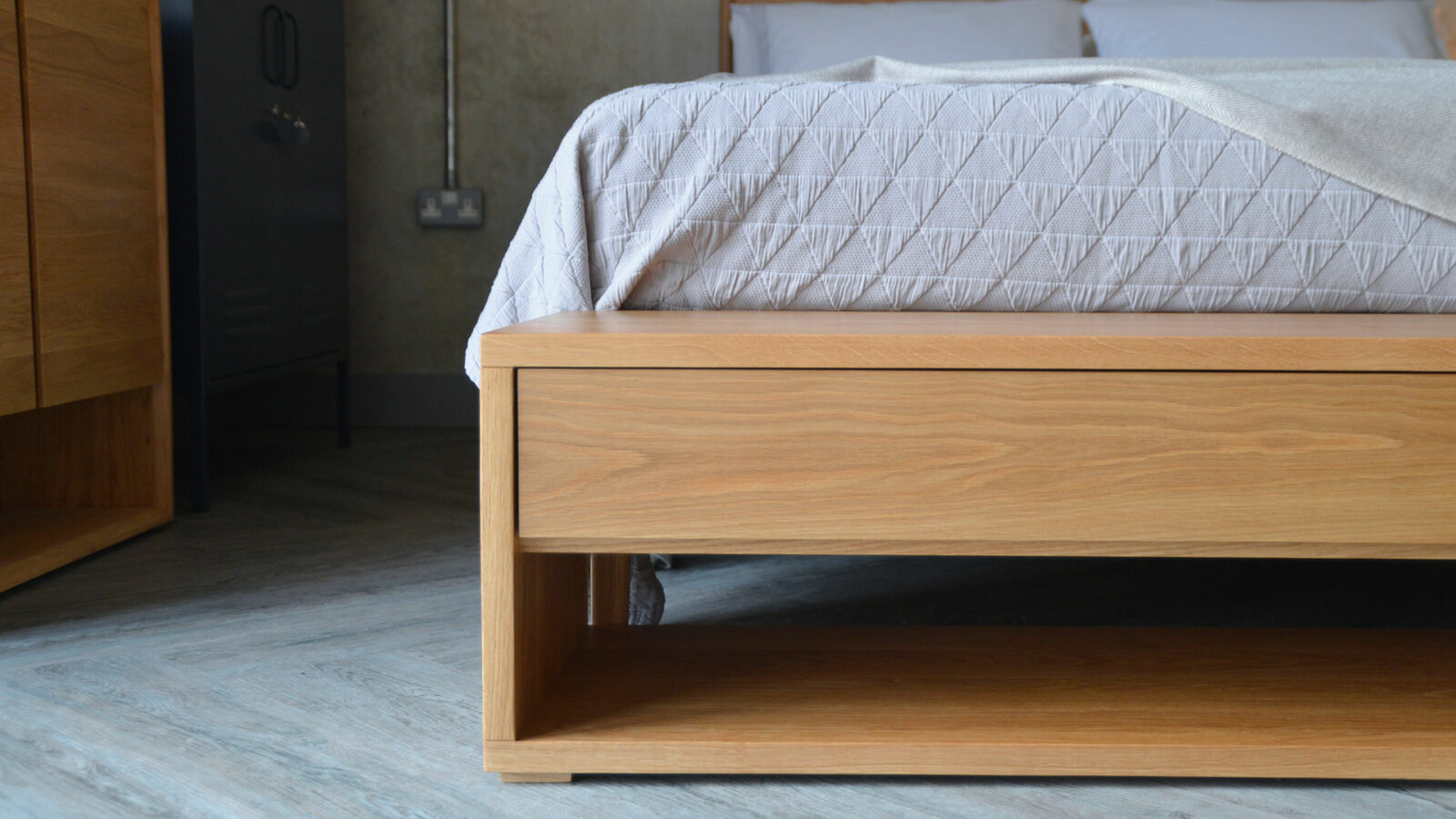 media unit or end of bed bench with storage drawer and open shelf, here in Oak
