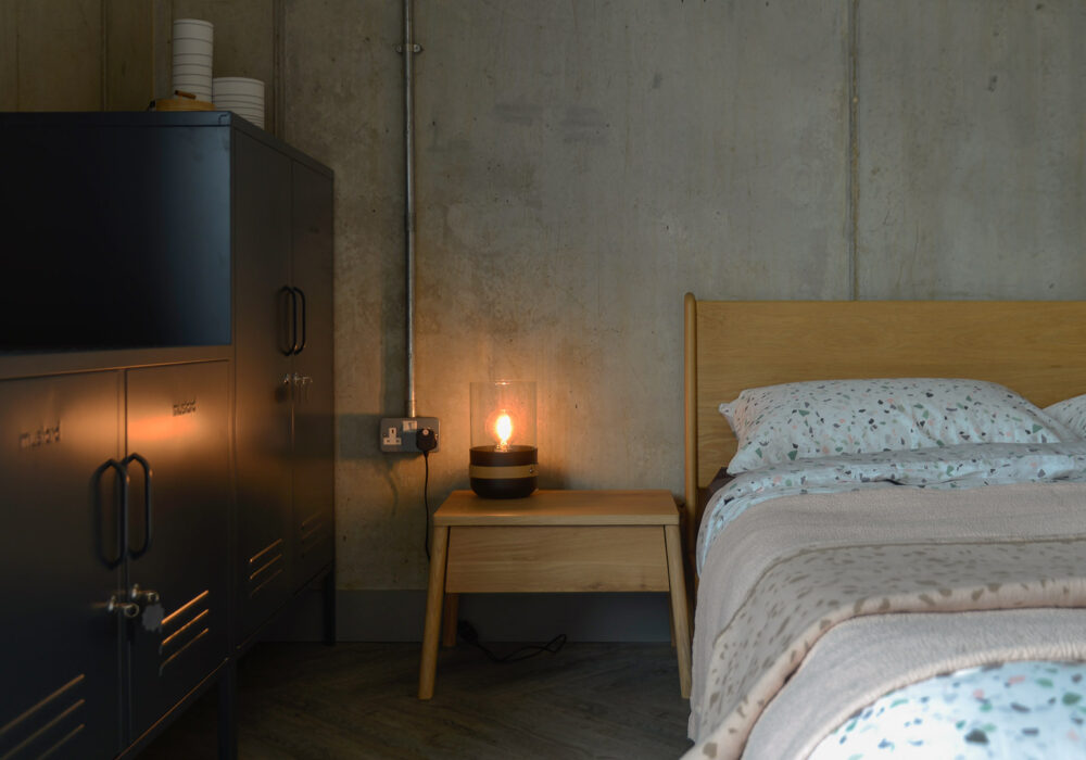 Air oak bedside drawer table next to our mid-century style low Carnaby bed.