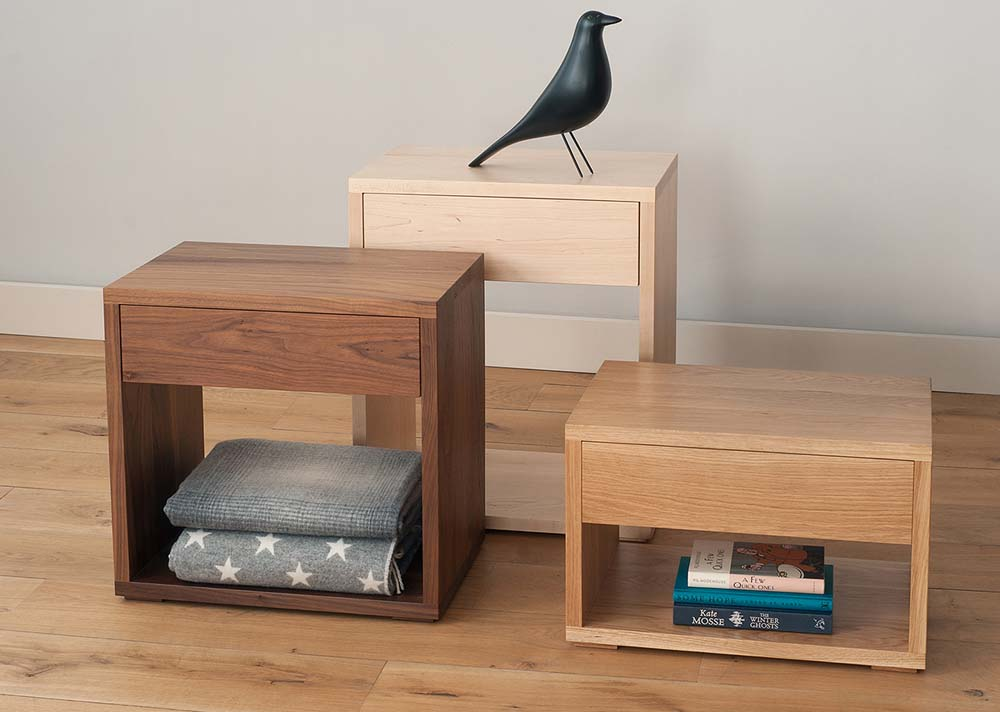 Bedside tables with a drawer and open shelf, available in a range of woods and in a choice of 3 heights.